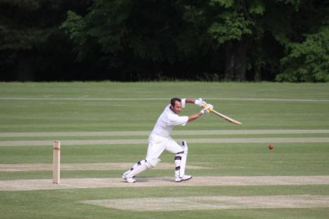 20 - Justin Manville executes a perfect cover drive.JPG