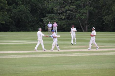 7 - Ian bowled and shakes James Weymes's hand.JPG