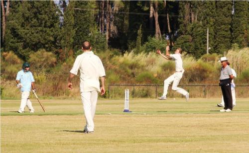 Samuel Nicholson runs in to bowl.JPG